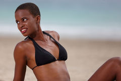 Woman in a bikini looking over her shoulder Royalty Free Stock Images