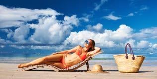 Woman in bikini lying on beach at Seychelles Stock Image