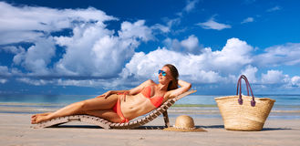 Woman in bikini lying on beach at Seychelles Royalty Free Stock Images