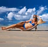 Woman in bikini lying on beach at Seychelles Royalty Free Stock Image
