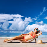 Woman in bikini lying on beach at Seychelles Stock Images