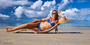 Woman in bikini lying on beach at Seychelles Royalty Free Stock Photography