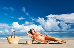 Woman in bikini lying on beach at Seychelles Royalty Free Stock Photos