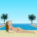 Woman in bikini lying near pool Stock Photo