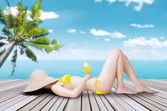 Woman with bikini lying on the pier Royalty Free Stock Photography