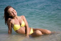 Woman in bikini lying  in sea Stock Photo