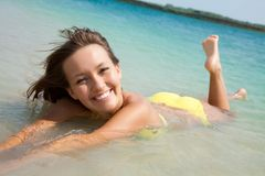 Woman in bikini lying  in sea Stock Image