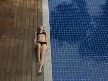 Woman In Bikini Lying By Swimming Pool Royalty Free Stock Images