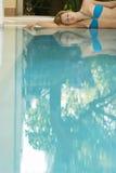 Woman In Bikini Lying By Swimming Pool Royalty Free Stock Photos