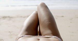 Woman In Bikini Lying Under The Bright Sun Stock Photography