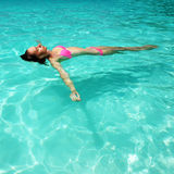 Woman in bikini lying on water Stock Image