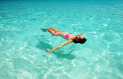 Woman in bikini lying on water Royalty Free Stock Image