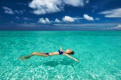 Woman in bikini lying on water Royalty Free Stock Images