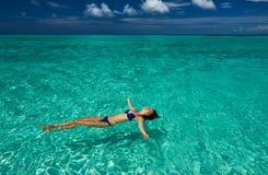 Woman in bikini lying on water Stock Photo