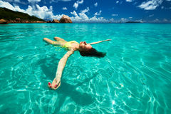 Woman in bikini lying on water Stock Photo