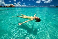 Woman in bikini lying on water Royalty Free Stock Image