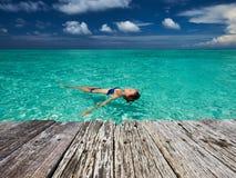 Woman in bikini lying on water Stock Photography