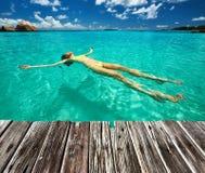 Woman in bikini lying on water Stock Image