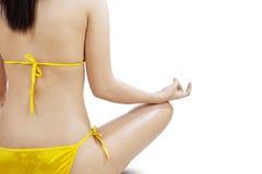 Woman in bikini meditating with lotus position Royalty Free Stock Photos