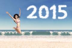 Woman in bikini with number 2015 Royalty Free Stock Image