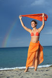 Woman in bikini and pareo holding scarf Stock Image