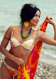 Woman in bikini and pareo at sea background Stock Images