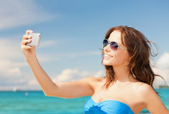 Woman in bikini with phone Royalty Free Stock Photo