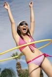 Woman In Bikini Playing With Hula Hoop Stock Images