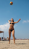 Woman in bikini playing volleyball outdoors Royalty Free Stock Image