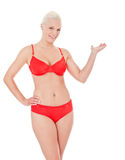 Woman in bikini points to the side Royalty Free Stock Photography