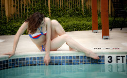 Woman in a bikini at the pool Royalty Free Stock Images