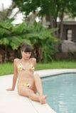 Woman in a bikini by the pool Stock Image