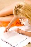 Woman in bikini, reading Royalty Free Stock Image