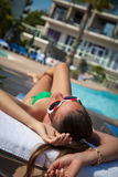 Woman in bikini relaxing at the pool Royalty Free Stock Images