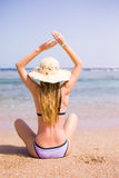 Woman in bikini resting on the beach in straw hat. Summer vocation Stock Photos