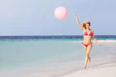 Woman In Bikini Running On Beautiful Beach With Balloon Stock Images