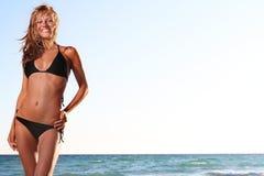 Woman in bikini on sea background Royalty Free Stock Photos