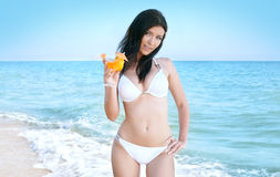 Woman in bikini at sea beach Royalty Free Stock Images