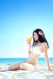 Woman in bikini at sea beach Stock Image