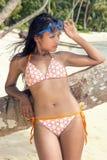 Woman in bikini on the sea beach Royalty Free Stock Image