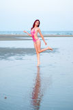 Woman in bikini at the sea, reflection on water Royalty Free Stock Photo