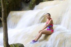Woman and bikini sexy sit in waterfall. At Erawan Waterfall and  natural in Kanchanaburi province, Thailand royalty free stock photo
