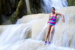 Woman and bikini sexy on waterfall. At Erawan Waterfall and  natural in Kanchanaburi province, Thailand royalty free stock photo