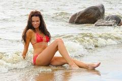 Woman in bikini sitting Stock Photos