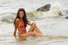Woman in bikini sitting Stock Images
