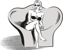 Woman in bikini sitting on a chair. In Royalty Free Stock Photography