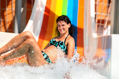 Woman in bikini sliding water park Stock Image