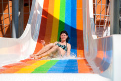 Woman in bikini sliding water park Stock Images