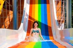Woman in bikini sliding water park Stock Photos