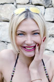 Woman in a bikini smiles Royalty Free Stock Photography